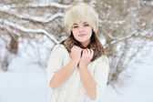 Snow winter woman portrait outdoors. Snowy white winter day — Stok fotoğraf