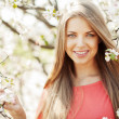 Beautiful spring girl in blooming tree — Stock Photo