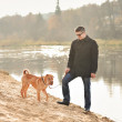 Man with a dog — Stock Photo