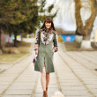 Full length portrait of happy woman walking with her little dog — Stock Photo
