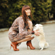 Portrait of beautiful woman with her little dog having good time — Stock Photo