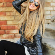 Beautiful young happy smiling woman in sunglasses — Stock Photo #38366327
