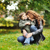 Happy mother hugging her little son. Family idyll concept — Stok fotoğraf