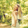 Outdoor portrait of young happy beautiful girl in a summer park — Stock Photo