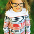 Stock Photo: Adorable little girl in glases - outdoors