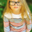 Sweet little girl wearing glasses - outdoor — Stock Photo #39979875