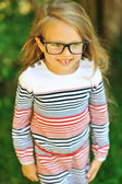 Adorable little girl in glases - outdoors — Stock Photo
