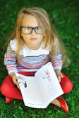 Portrait of sweet little girl with a book — Stock Photo