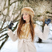 Pretty young woman dreaming in a forest — Stock Photo
