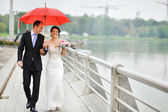 Young wedding couple walking at their wedding day — Stock Photo