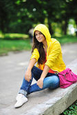 Young beautiful stylish girl with bag in a summer park — Stock Photo