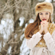 Frozen young woman in winter with hands next to her face - close — 图库照片 #41575199