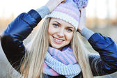 Closeup portrait of attractive young blonde girl with hands next — Stock Photo