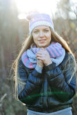 Portrait of attractive young girl with hands cupped. Outdoors — Stock Photo