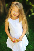 Cute little girl portrait on a summer green park — Stock Photo