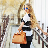 Sexy young beauty woman in sunglasses with bag  — Stock Photo