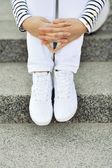 White sneakers on girl legs - closeup  — 图库照片