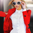 Fashionable girl in red dress wearing sunglasses  — Stock Photo #43834667