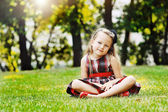 Beautiful little girl portrait in a summer green park  — Stock Photo