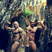 Two bodybuilders posing outdoors - copyspace — Stock Photo
