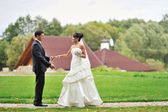 Bride and groom in a park - outdoor portrait  — Stock Photo