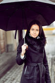 Beautiful young woman with umbrella  — Stock Photo