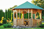 Outdoor wooden gazebo over summer landscape background — Stock Photo