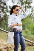Stylish young woman - outdoor portrait — Stock Photo