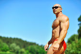 Muscular man outdoor portrait - copyspace — Stock Photo
