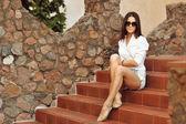 Beautiful woman white shirt in sunglasses — Stock Photo