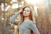 Beautiful blonde woman with perfect long chic hair — Stock Photo