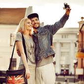 Young couple taking self portrait photo at old camera — Stock Photo