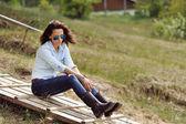 Attractive young brunette outdoor portrait  — Stock Photo