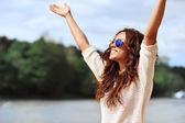 Happy smiling woman with hands raised - outdoor portrait  — Stock Photo