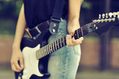 Close up photo of guitar female player — Stock Photo