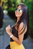 Young beautiful smiling woman in sunglasses at sunny day — Stock Photo