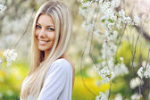 Beautiful blonde woman in spring — Stock Photo