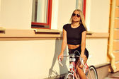 Sexy girl on a vintage bicycle — Stock Photo