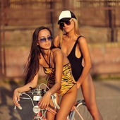 Two beautiful girls posing outdoor  — Photo
