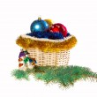 Decorated Christmas basket with Christmas toys and tinsel, isolated on white background — Stock Photo
