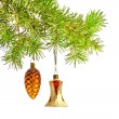 Christmas bell and cone toys with Christmas tree — Stock Photo