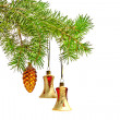 Christmas bells and yellow cone toys  hanging on a green spruce — Foto Stock