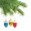 New year toys. Red, yellow and blue cones on christmas tree — Stock Photo