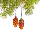 Christmas yellow and red cones toys and fur tree — Stock Photo