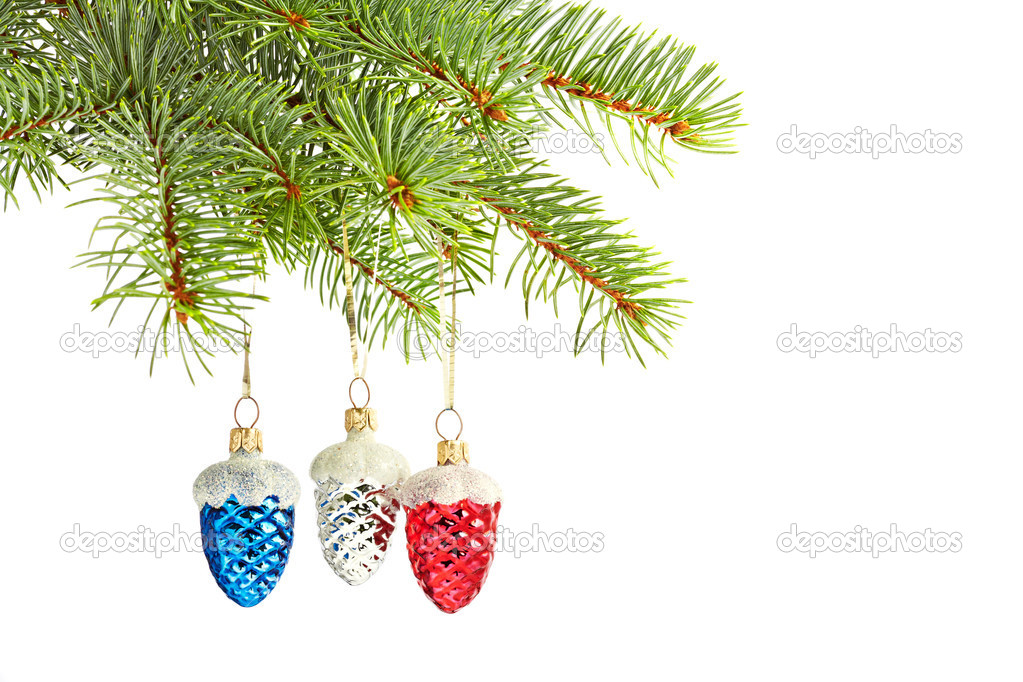 Christmas toys. Multi-colored cone toys on christmas tree — Stock Photo #17660337