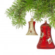 Christmas yellow and red bells on new year tree — Stock Photo