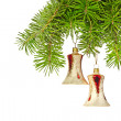 Christmas yellow bells on new year tree — Stock Photo #18108507