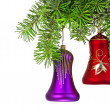 Christmas violet and red bells on new year tree — Stock Photo