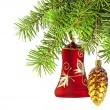 Christmas red bell and golden cone  on new year tree — Stock Photo