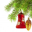 Christmas red bell and golden cone  on new year tree - Stock Photo